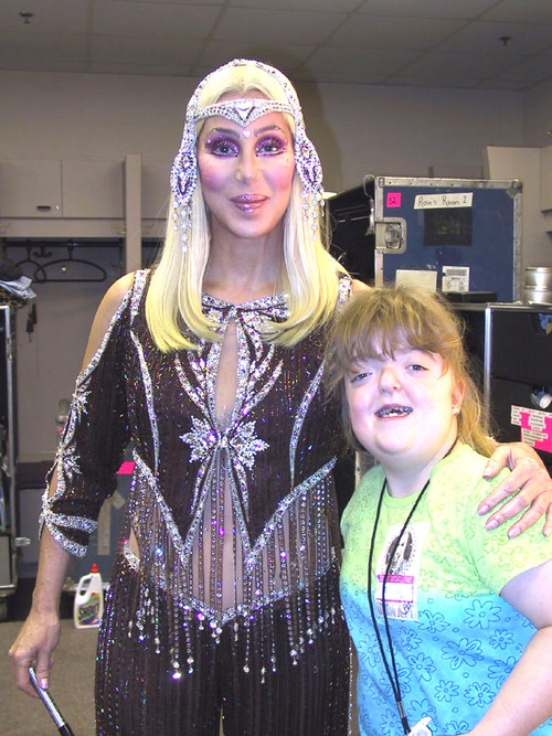 Cher with her typical fan